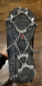 Trent's winter boots with shoe chains on